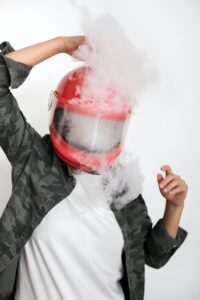 person imitate emotional top, vaping in helmut
